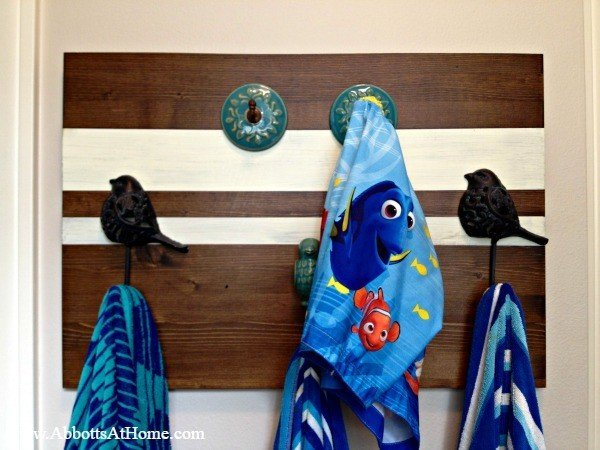 This DIY towel rack (or coat rack) is a quick and easy DIY project. Add a touch of your own style to your any room in your house with cute knobs and hooks.