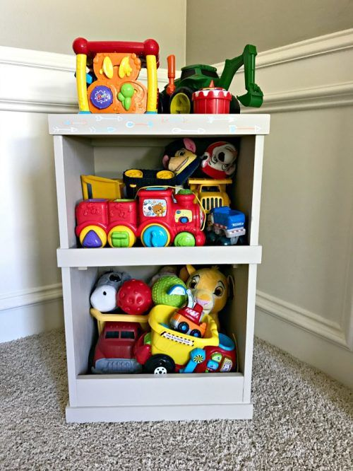 Build this DIY Hidden Toy Storage. Adding furniture sliders or casters to this cute storage hides the messy toys in the back, while your kids cute books are displayed on the front.