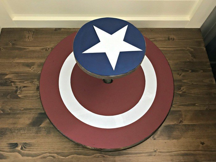 You can make your own easy DIY kids sit & spin toy. And it's pretty easy with pre-cut wood rounds and galvanized pipes and flanges. I've even included the free Captain America Printable as a download.