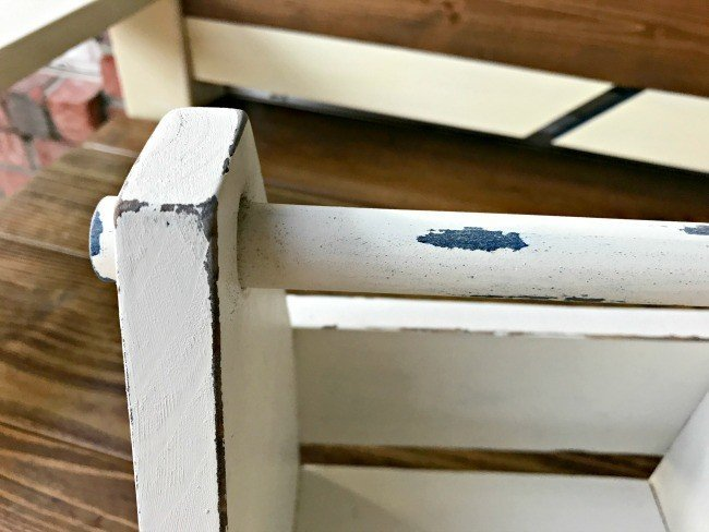 Close up of paint distressing on my DIY Beer Caddy. Get the DIY Steps and my secret to How to paint and distress furniture perfectly, every time. #Distressing #FurnitureMakeover #ChippyFurniture