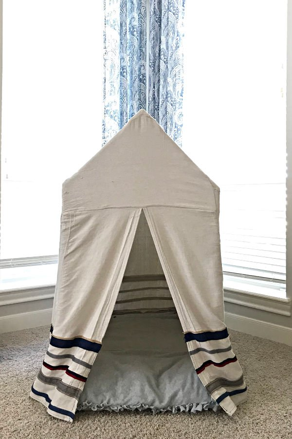 Here are the quick and easy steps to build a fun Kids PVC Pipe Tent. No power tools required. Build this cheap little playhouse in a couple hours.