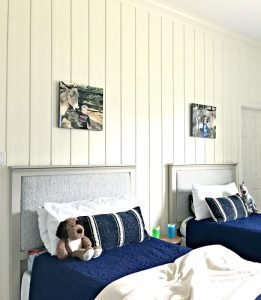 This beautiful DIY Board and Batten Wainscoting has completely updated this bedroom with a new high end designer look. And it was pretty easy. See the full tutorial and DIY tips here. #AbbottsAtHome #Wainscoting #DIYProjects #HomeRemodeling