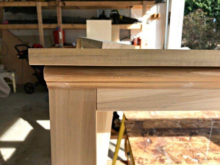 Nail holes filled. A closer look at the wood headboard top.