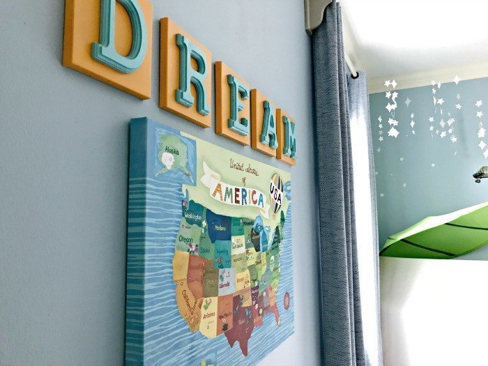It's time for the boys bedroom makeover reveal, guys! And I'm so excited to share it with you. The whole room is full of awesome DIY projects, affordable decor, and fun boys bedroom ideas. I'm loving it and so are my boy's! This is a blue, white, and grey bedroom full of pops of fun colors. I think it's a bit Modern Farmhouse, a bit traditional, and a bit Land of Nod. I designed this for my boys, but most of the ideas would work for all kids, boys and girls. #kidsbedroom #kidsroom #boysbedroom