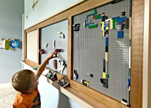 A cedar and grey Modern Farmhouse Kids Activity Wall. Build a fun DIY Modern Farmhouse Kids Activity Wall Board. With 20 Ideas for board options that work for kids, teens, and adults. #ModernFarmhouse #KidsFurniture #DIYKids #AbbottsAtHome