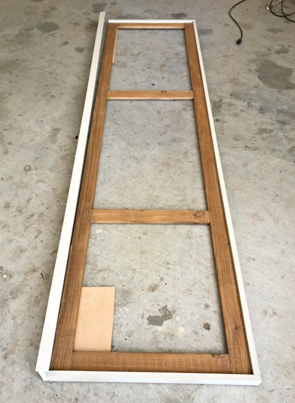 Cedar frame built. Now, I'm attaching the painted outer frame. Build a fun DIY Modern Farmhouse Kids Activity Wall Board. With 20 Ideas for board options that work for kids, teens, and adults. #ModernFarmhouse #KidsFurniture #DIYKids #AbbottsAtHome