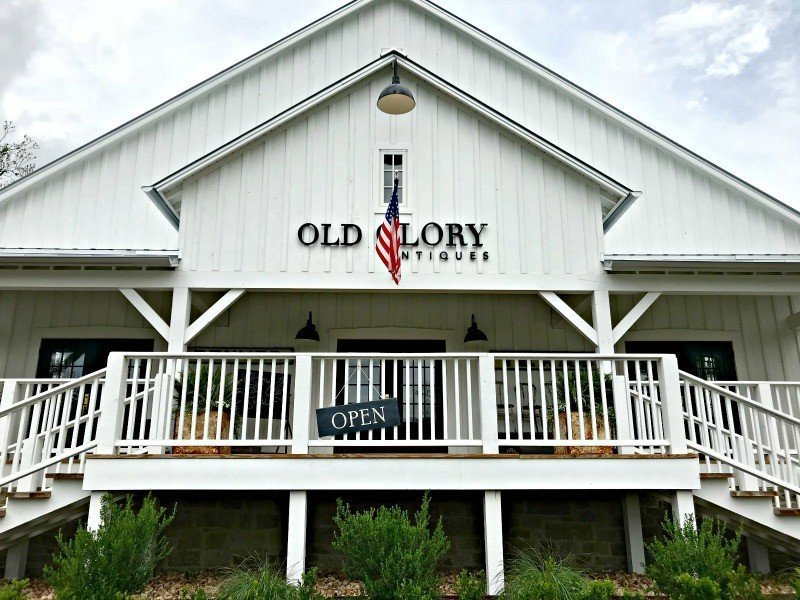 Outside Old Glory Antiques location in Round Top, Texas. The Spring and Fall Round Top Texas Antiques and Flea Markets are great! BUT you can find Fun, Art & Furniture Shopping in Round Top, Texas year round, guys! Check out photos from the shops in town. #RoundTop #TexasTravel #AbbottsAtHome