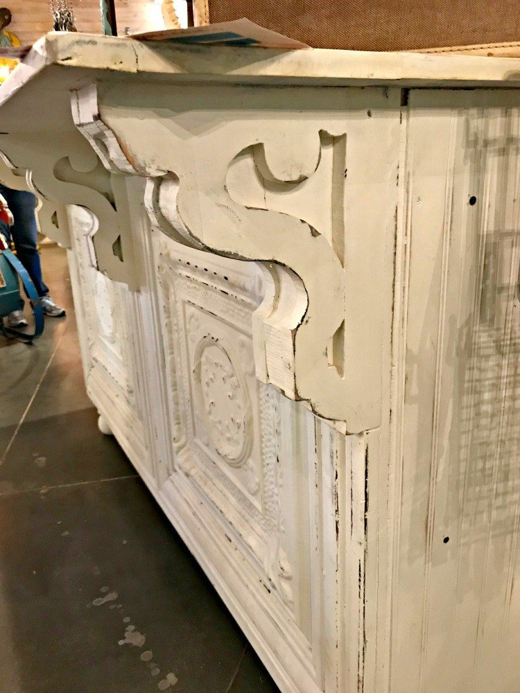 A close up of the white distressed corbels on a bar. A few more Round Top Shopping Trip Tips and some photos from the Junk Gypsy Headquarters. A shopping trip to Round Top and Waco would make a perfect weekend, guys! #AbbottsAtHome #RoundTopTexas #JunkGypsy #GirlsWeekend