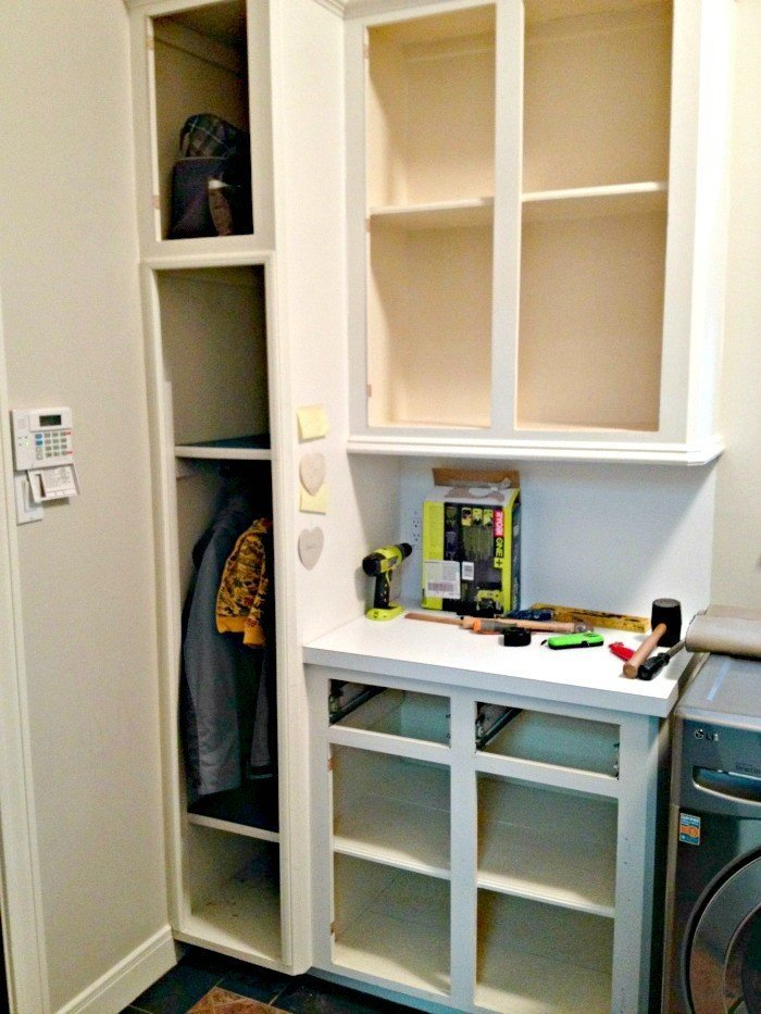 Getting started transforming these cabinets in the Laundry Room into a Mudroom Bench, Hall Tree, and Coat Storage. This Modern Farmhouse DIY Laundry Room Makeover Ideas post is full of Before & After Makeover Photos, budget-friendly DIY ideas, and Laundry Room decor. #LaundryRoom #BeforeandAfter #AbbottsAtHome
