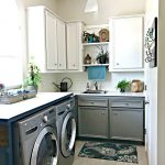 After makeover photos on a white and grey Laundry Room with Teal accents and lots of budget-friendly DIY. This post is full of Before & After Makeover Photos, budget-friendly DIY ideas, and Laundry Room decor. #LaundryRoom #BeforeandAfter #AbbottsAtHome