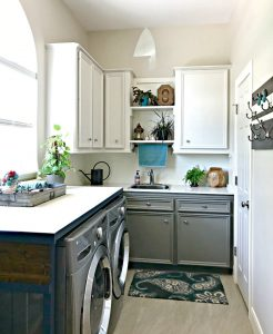 Behr's Sandstone Cove on the walls and upper cabinets, Behr's Squirrel on the lower cabinets. This post is full of Before & After Makeover Photos, budget-friendly DIY ideas, and Laundry Room decor. #LaundryRoom #BeforeandAfter #AbbottsAtHome