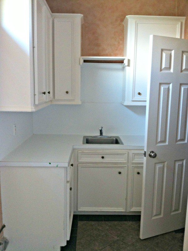 Before photo on my white and grey Boho & Farmhouse Style Laundry Room Makeover. This Modern Farmhouse DIY Laundry Room Makeover Ideas post is full of Before & After Makeover Photos, budget-friendly DIY ideas, and Laundry Room decor. #LaundryRoom #BeforeandAfter #AbbottsAtHome
