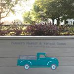 A vintage blue truck drawing on a bench back. Build this DIY Rustic Farmhouse Outdoor Bench with just a drill and a saw. This is a great 2x4 bench project. #AbbottsAtHome #DIYBench #DIYFurniture #2x4bench