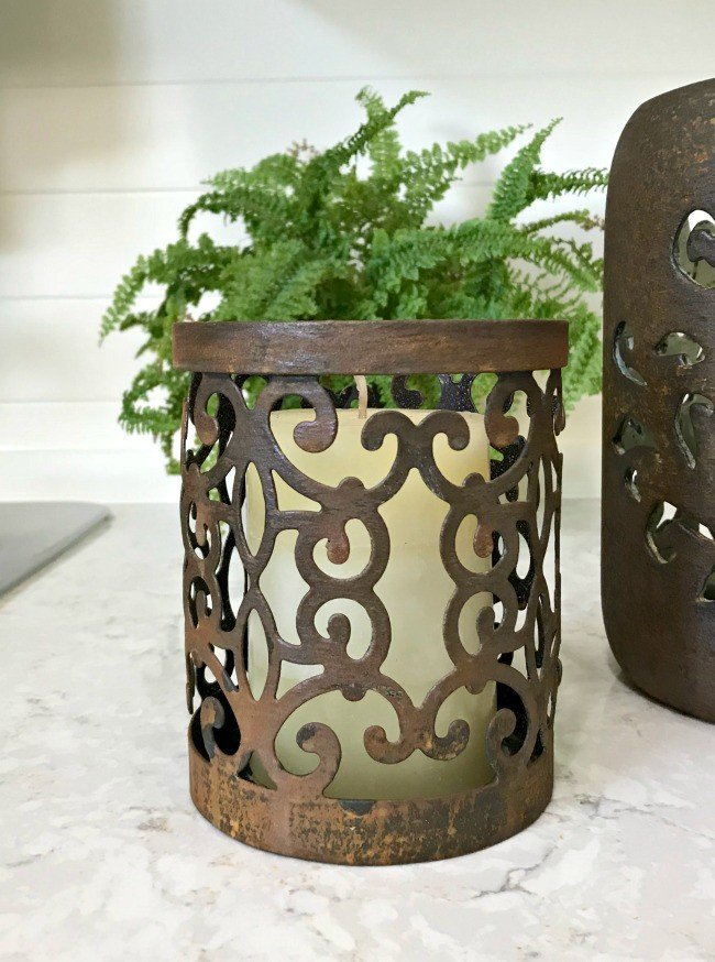 A close up of a metal candle holder updated with rust patina paint. Update your old decor with this DIY Rust Paint Technique. I love how easy this is, just paint and spray! #PatinaPaint #Rust #DixieBellePaint #AbbottsAtHome