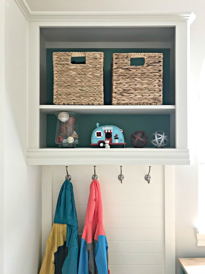 DIY Hall Tree from converted wall cabinet. Our White and Teal Colorful Laundry Room Makeover is done! You won't believe the Laundry Room Before and After photos. This Colorful Modern Farmhouse Laundry Room makeover uses teal, wood, and lots of white to freshen and lighten the whole space. #LaundryRoom #ModernFarmhouse #Teal #AbbottsAtHome