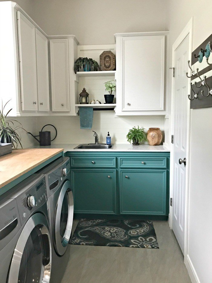 Our White and Teal Colorful Laundry Room Makeover is done! You won't believe the Laundry Room Before and After photos. This Colorful Modern Farmhouse Laundry Room makeover uses teal, wood, and lots of white to freshen and lighten the whole space. #LaundryRoom #ModernFarmhouse #Teal #AbbottsAtHome