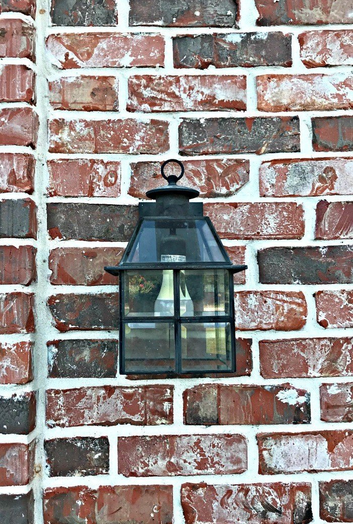 Try this Easy LED Flame Effect Fire Bulb Front Porch Makeover. This quick DIY will give your front porch instant curb appeal with that classic gaslight look! #AbbottsAtHome #CurbAppeal #FrontPorch #Gaslight #LEDBulb #PorchMakeover