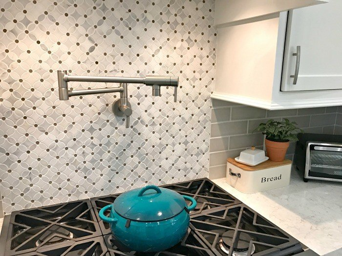 This Moen Pot Filler has clean lines and a classic look that worked great with our marble tile. Tips for Building a New Home