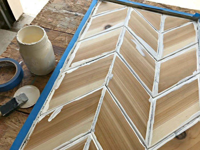 Build this fun and easy DIY Chevron Wood Wall Art for less than $20. Design your own custom look with your favorite wood, paint, and stains. #AbbottsAtHome #WoodArt #WoodworkingIdea #DIYProjects #WallArt