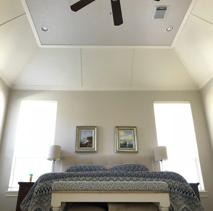 Going for a light grey color on the walls and ceiling makes this beautiful tray ceiling millwork pop! #AbbottsAtHome #LightWalls #WhiteWalls #GreyWalls #PaintIdeas
