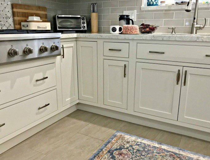 Caulking that small gap between the cabinets and the floor is an easy way to make your kitchen look nicer. And it stops all of those crumbs and spills from hiding under those cabinets. YASSS! #AbbottsAtHome #Kitchen #KitchenCabinets #StarmarkCabinets #InsetCabinets # DIYIdeas