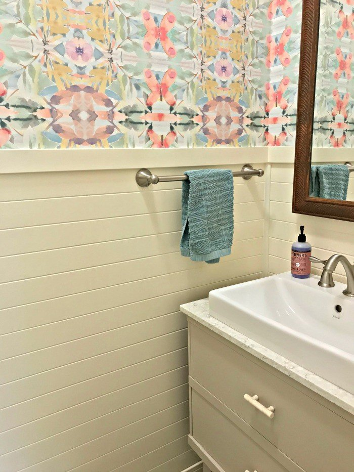 You'll love these Small Colorful Modern Farmhouse Powder Room Ideas! Anthropologie Synchronized Wallpaper, DIY Vanity from a Dresser, DIY V-Groove Panel with a Farmhouse Vessel Sink. This was my first time hanging wallpaper and I was able to get it done in 1 day! #Wallpaper #AbbottsAtHome #PowderRoom #BathroomIdeas #ModernFarmhouse