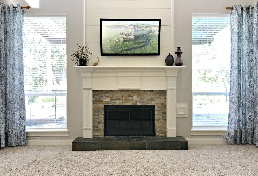 Shiplap Fireplace with a TV above the mantle in a Living Room with vaulted ceilings. She's got the details for how to recreate this look. #Shiplap #Fireplace #FarmhouseStyle #AbbottsAtHome