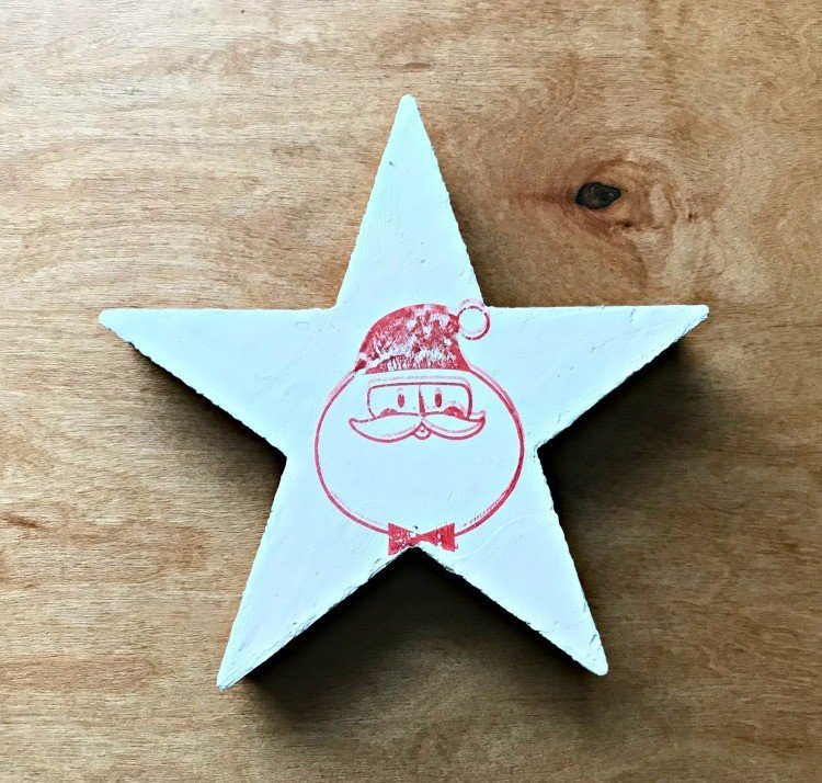 Christmas Stamp Ornament. Need some new ideas for this years Christmas craft? I've got 12 fun and easy handmade Christmas Ornament Ideas for you! Make 3D scrapbook paper trees, pom pom trees, star string art, unicorn stars, and more. #AbbottsAtHome #Handmade #ChristmasCrafts #ChristmasIdeas #ChristmasOrnaments