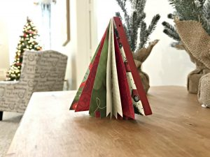 3D Scrapbook Paper Christmas Tree. Need some new ideas for this years Christmas craft? I've got 12 fun and easy handmade Christmas Ornament Ideas for you! Make 3D scrapbook paper trees, pom pom trees, star string art, unicorn stars, and more. #AbbottsAtHome #Handmade #ChristmasCrafts #ChristmasIdeas #ChristmasOrnaments
