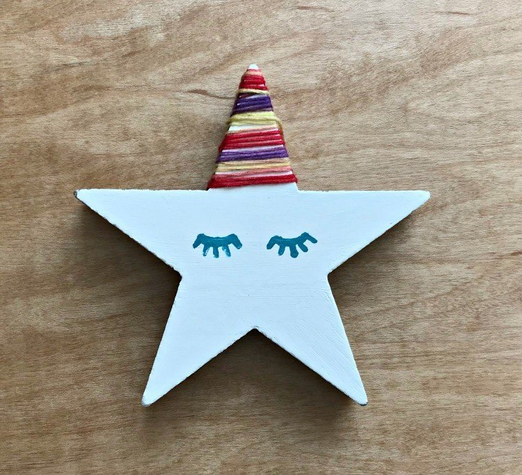Unicorn Star Ornament. Need some new ideas for this years Christmas craft? I've got 12 fun and easy handmade Christmas Ornament Ideas for you! Make 3D scrapbook paper trees, pom pom trees, star string art, unicorn stars, and more. #AbbottsAtHome #Handmade #ChristmasCrafts #ChristmasIdeas #ChristmasOrnaments
