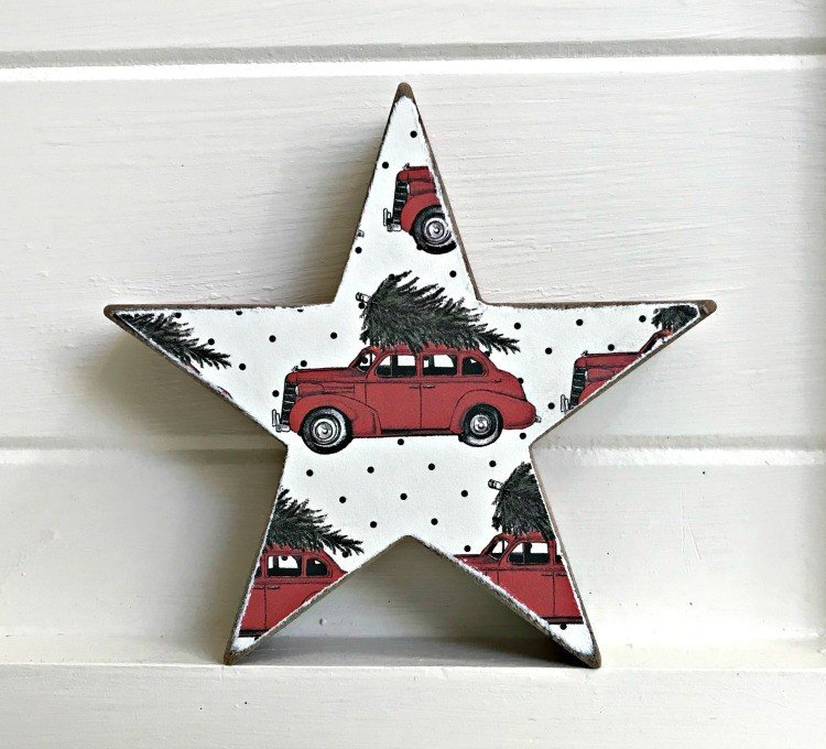Distressed Paper Star Ornament. Need some new ideas for this years Christmas craft? I've got 12 fun and easy handmade Christmas Ornament Ideas for you! Make 3D scrapbook paper trees, pom pom trees, star string art, unicorn stars, and more. #AbbottsAtHome #Handmade #ChristmasCrafts #ChristmasIdeas #ChristmasOrnaments