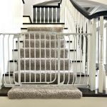 Here's a cheap and easy DIY that I have loved for 4 years. It's my DIY Baby Gate Hack for Stairs. And, this thing is sturdy. My boys have both stood at that gate and shook it back and forth. And it did not budge at all. Yaasss! Here's my tutorial for how to make this baby gate work for stairways and banisters. Works with wide openings too. #AbbottsAtHome #Stairways #BabyGate #Babyproof #BabySafety #HomeDIY #HomeSafety