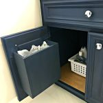 How to make built in cabinet garbage cans in a bathroom or kitchen. See the easy DIY Steps and build pictures. #AbbottsAtHome #BathroomReno #BathroomRemodel #GarbageCan #GarbageIdeas #OrganizationIdeas