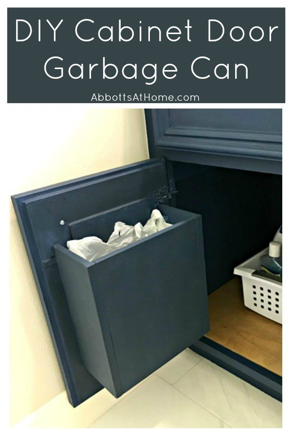 You can hide that bathroom garbage away when you build your own custom DIY Cabinet Door Mounted Garbage Can. This a quick and easy DIY win! #AbbottsAtHome #BathroomStorage #BathroomIdeas #DIYIdeas