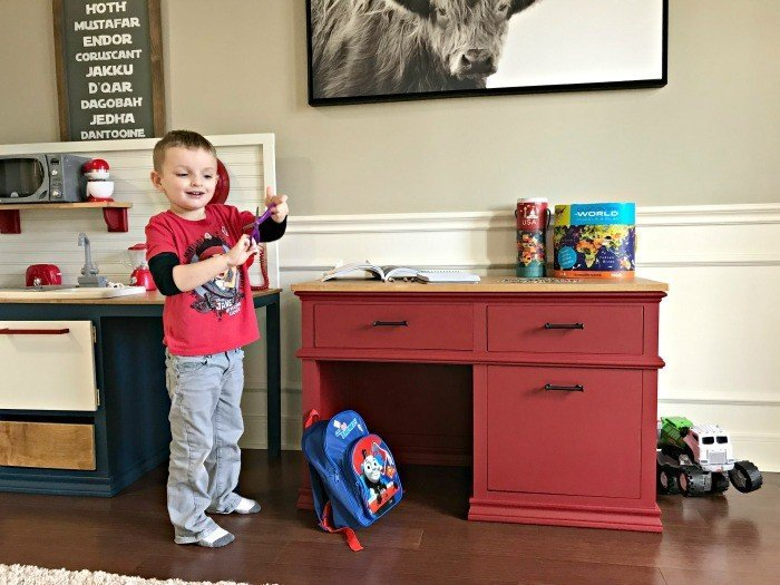 Here's how to build a super cute, Pottery Barn Style DIY Kids Desk with Storage. With free printable plans! This Little Kids Wood Desk has 3 big drawers for lots of storage and a classic look that'll make a pretty family heirloom piece. #DIYFurniture #BuildPlans #Woodworking #KidsDesk #AbbottsAtHome