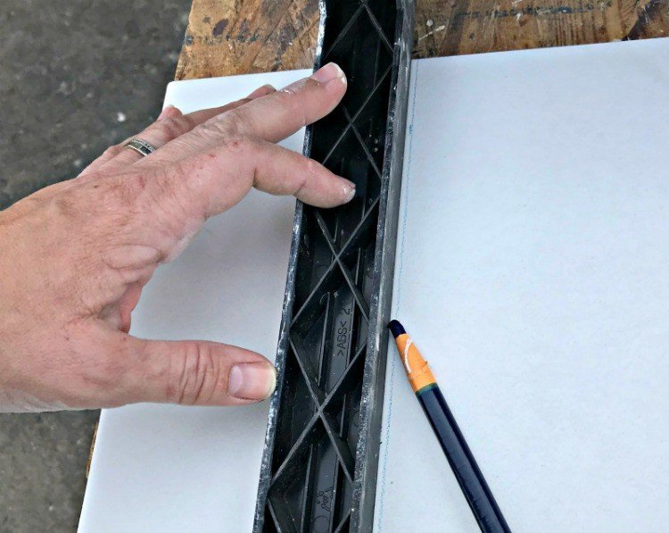 Use a China Marker to make cutting guides on tiles. Here are my DIY Tips for Installing Floor Tile Faster and Better.