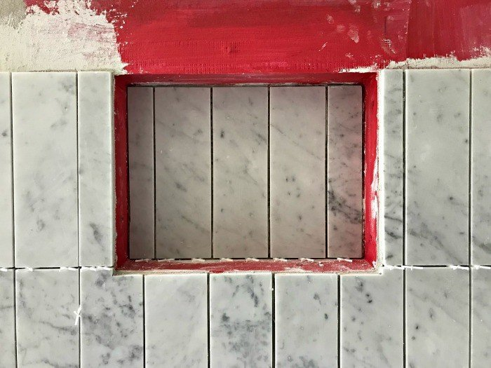 I matched my mosaic marble tiles with this pretty 4 x 12 marble subway tile ran vertically. #AbbottsAtHome #MosaicTile #MarbleTile #BathroomTile