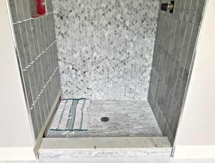 I went with a large marble subway and 2 marble mosaic tile patterns in this bathroom makeover. I cannot wait to see this finished, guys! #AbbottsAtHome #MosaicTile #MarbleTile #BathroomTile