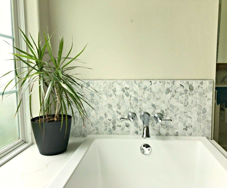 More Master Bathroom Remodeling Pictures from my latest room makeover. I love how this classic grey marble tile looks with those light walls and dark blue accents. #AbbottsAtHome #BathroomMakeover #BathroomDesign #SoakerTub #BackSplash