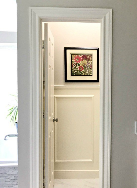 Picture Frame Wainscoting is a beautiful and timeless look. AND, it's actually really easy to install. Here are my DIY tips and tutorial video! #Wainscot #Wainscoting #AbbottsAtHome #Moulding #ChairRail #PictureFrame