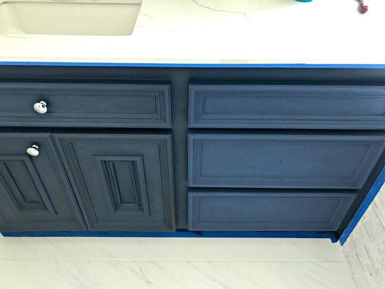 Napoleonic Blue Annie Sloan Chalk Paint with dark wax on the left side, clear wax on the right. DIY Chalk Paint Bathroom Vanity Makeover. #AbbottsAtHome #BathroomIdeas #HomeRemodeling #BathroomReno