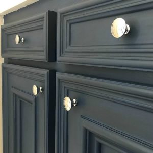 DIY Napoleonic Blue Bathroom Vanity Makeover with dark wax and pretty chrome knobs. #AbbottsAtHome #BathroomIdeas #BathroomDesign #BathroomCabinets #AnnieSloan