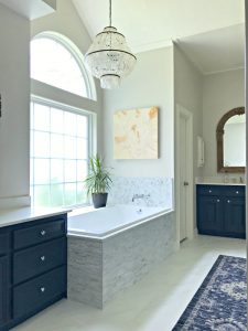 Yay! Our Bathroom Remodel is finished and I finally get to share all of the Before and After Master Bathroom Remodel photos with you guys. I've got all of the DIY projects and design details behind this DIY Bathroom Remodel with a walk in shower and drop in tub. #AbbottsAtHome #BathroomDecor #MasterBathroom #MasterBathroomIdeas #TileIdeas #DropInTub #SoakingTub