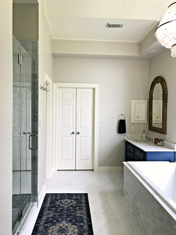 Yay! Our Bathroom Remodel is finished and I finally get to share all of the Before and After Master Bathroom Remodel photos with you guys. I've got all of the DIY projects and design details behind this DIY Bathroom Remodel with a walk in shower and drop in tub. #AbbottsAtHome #BathroomDecor #MasterBathroom #MasterBathroomIdeas #TileIdeas #HomeRemodeling