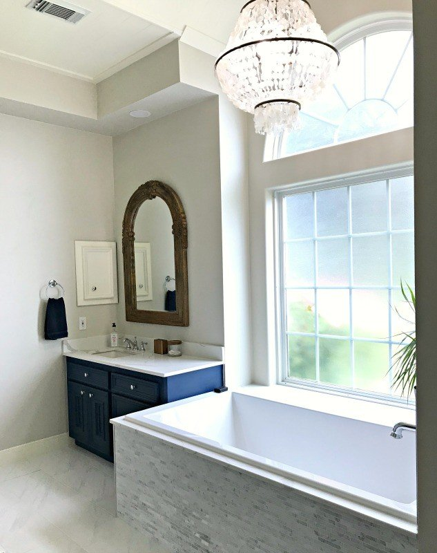 Yay! Our Bathroom Remodel is finished and I finally get to share all of the Before and After Master Bathroom Remodel photos with you guys. I've got all of the DIY projects and design details behind this DIY Bathroom Remodel. #AbbottsAtHome #BathroomDecor #MasterBathroom #MasterBathroomIdeas #TileIdeas #HomeRemodeling