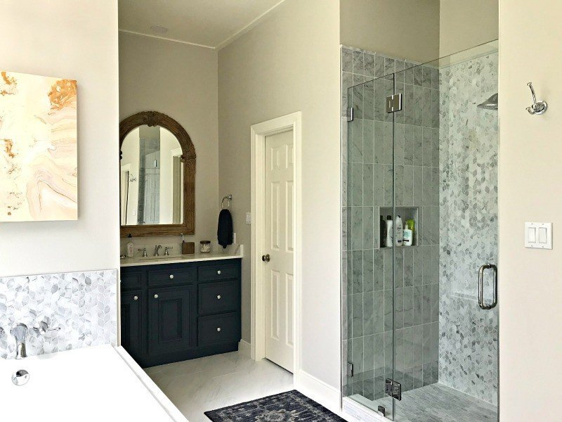 Yay! Our Bathroom Remodel is finished and I finally get to share all of the Before and After Master Bathroom Remodel photos with you guys. I've got all of the DIY projects and design details behind this DIY Bathroom Remodel with a walk in shower and drop in tub. #AbbottsAtHome #BathroomDecor #MasterBathroom #MasterBathroomIdeas #TileIdeas #HomeRemodeling #ShowerTile #ShowerIdeas
