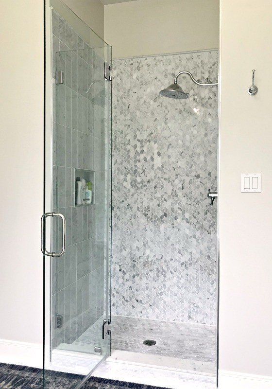 Yay! Our Bathroom Remodel is finished and I finally get to share all of the Before and After Master Bathroom Remodel photos with you guys. I've got all of the DIY projects and design details behind this DIY Bathroom Remodel with a walk in shower and drop in tub. #AbbottsAtHome #BathroomDecor #MasterBathroom #MasterBathroomIdeas #TileIdeas #HomeRemodeling #WalkInShower