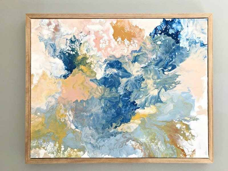 Make your own stunning art for less than $20 with this pretty DIY Paint Pouring Wall Art Idea & Tutorial. I love this DIY Art Project, guys! Anyone can do this. #AbbottsAtHome #WallArt #PaintPouring #PouringPaint #AcrylicPaint #DIYDecor
