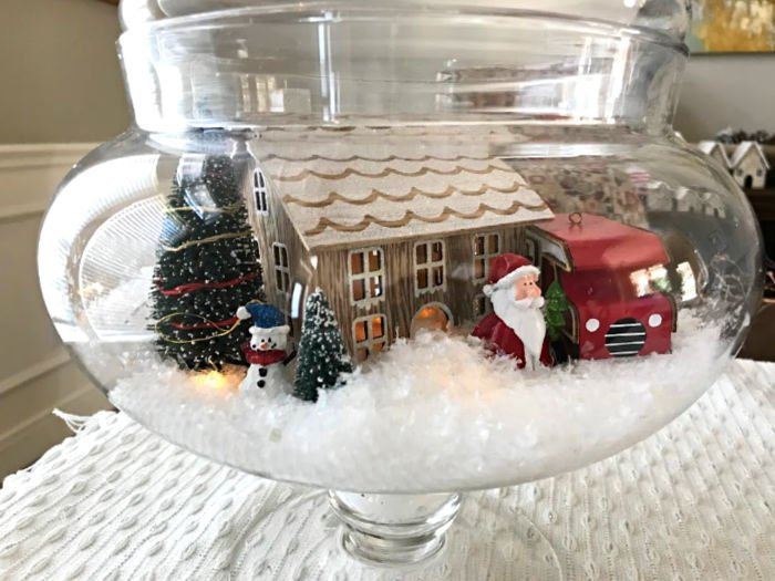 Looking for Easy Christmas Craft Inspo? Here's how I use Christmas ornaments, glass containers, and wooden bowls to design little Modern Farmhouse Christmas Villages my family loves. With how-to video and lots of photo inspiration. #AbbottsAtHome #Christmas #RedTruck #ChristmasDecor #ChristmasDecorations #ChristmasCraft