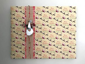Gift Wrapped Pictures - Easy DIY Christmas Wall Art with gift wrap tips and video to help you decorate for Christmas. #AbbottsAtHome #ChristmasDecor #ChristmasDecorations #ChristmasCrafts #DIYChristmas